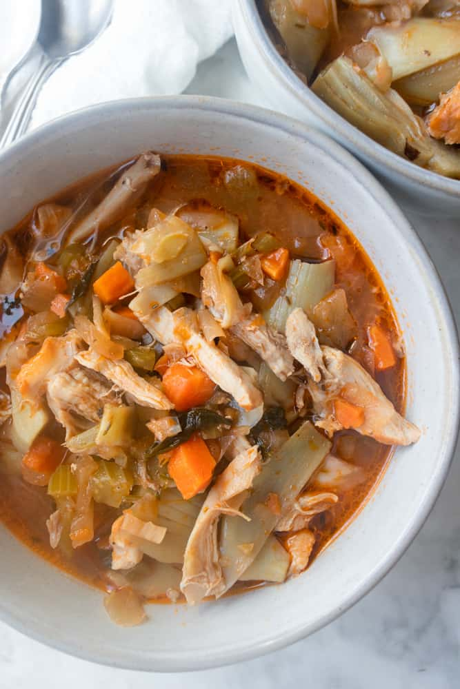 a close up of the Chicken and Artichoke Stew in a bowl