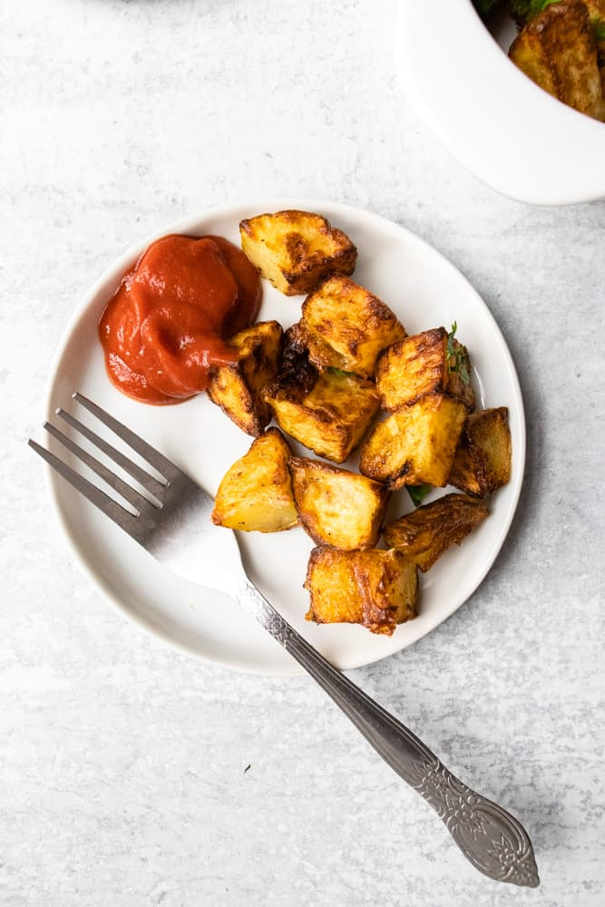 a small play of air fryer home fries and a side of ketchup