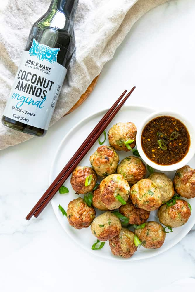 a plateful of pork dumpling meatballs with the coconut aminos dipping sauce