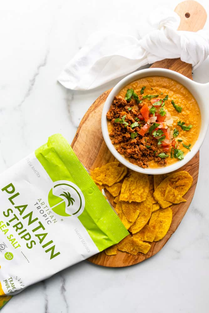 queso fundido con chorizo with a bag of plantain chips