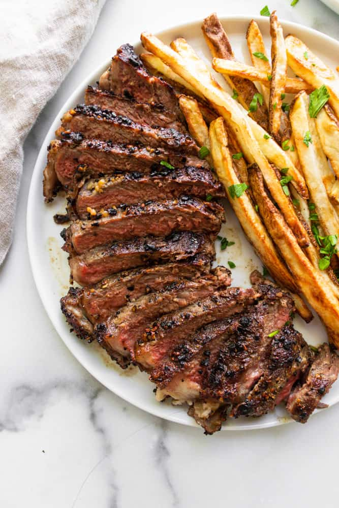 a close up of the steak frites focusing on the steak