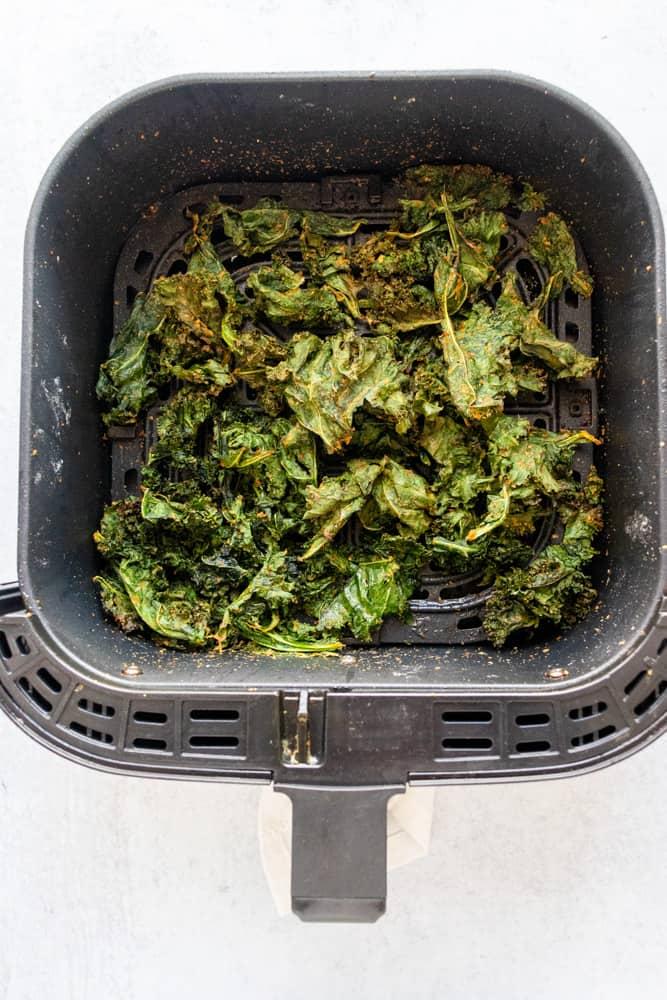 air fryer kale chips in an air fryer basket