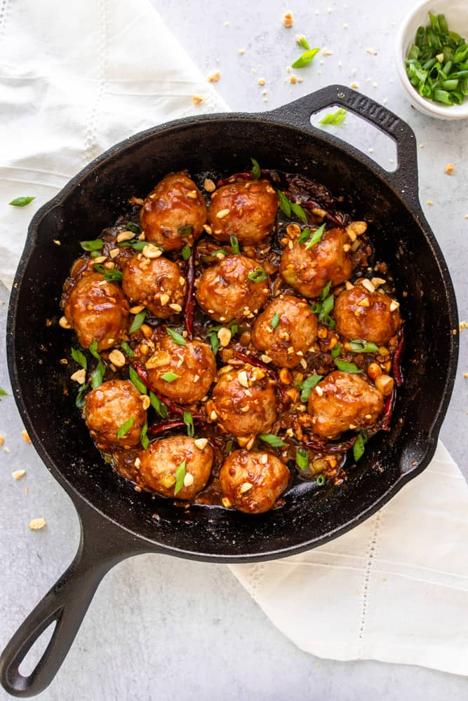 kung pao chicken meatballs in a cast iron skillet