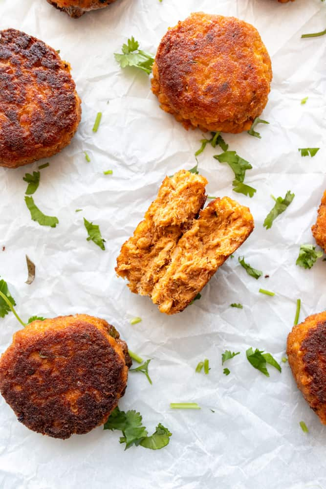 one of the red curry salmon cakes is split in half to show inside