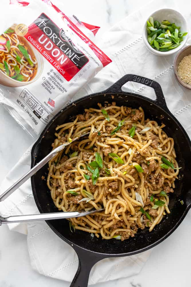overview of sesame ginger udon stir fry that's in a skillet