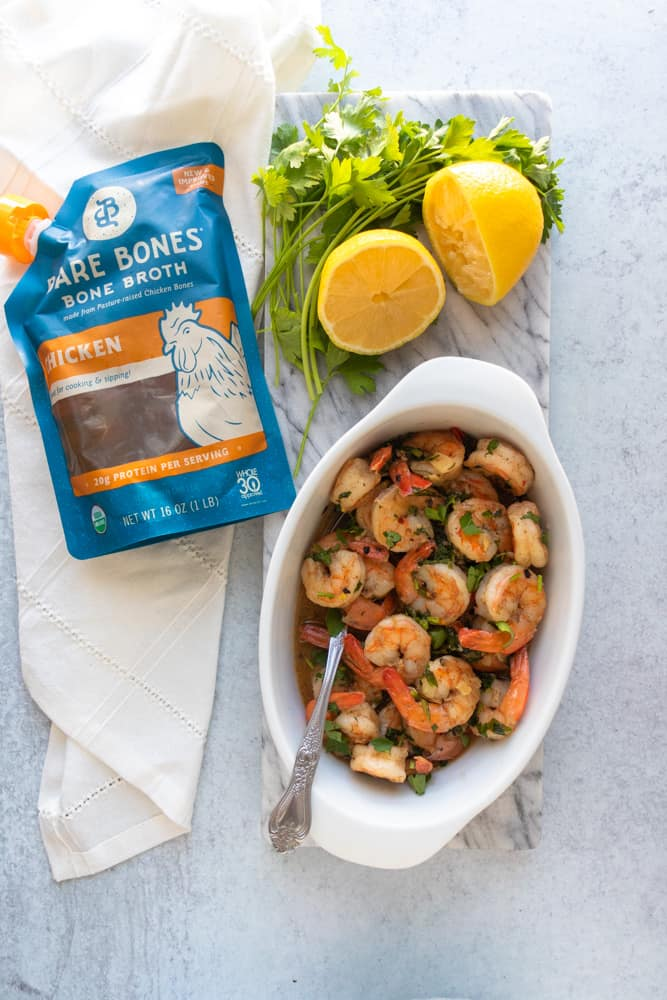 overview of shrimp scampi with a bag of bare bones broth next to it
