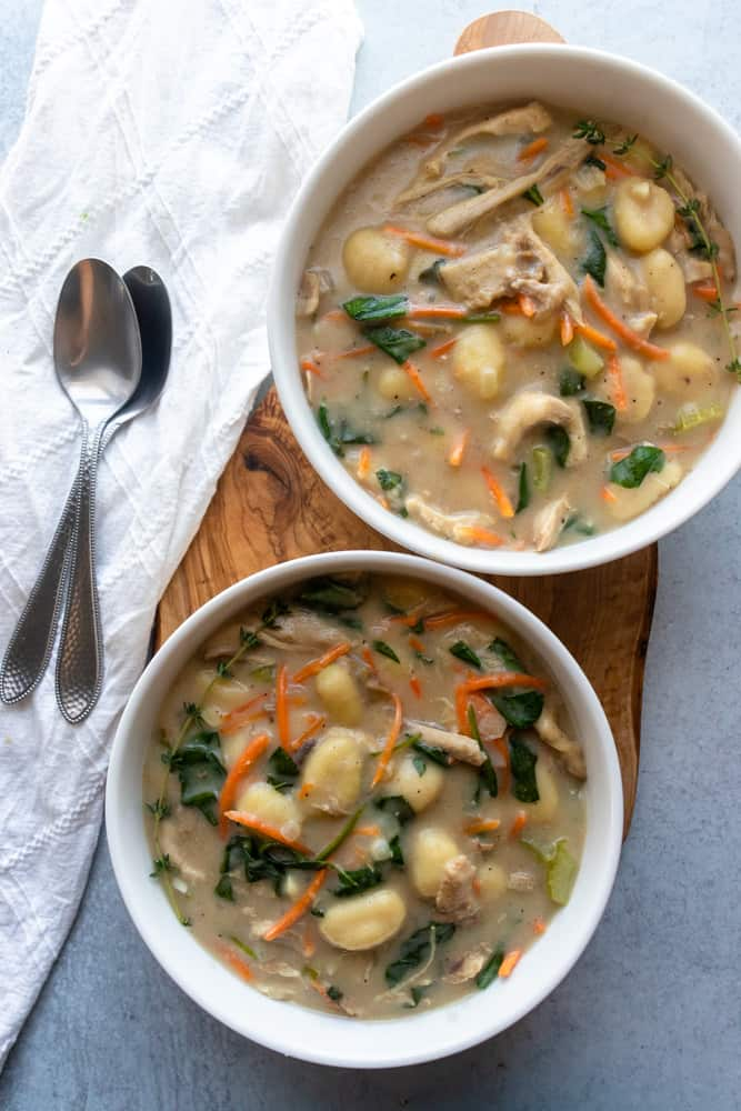 two bowls of chicken gnocchi soup