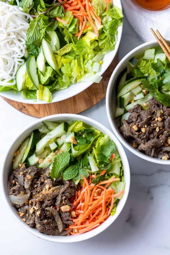 two bowls of bun bo xao (vietnamese lemongrass beef noodle)