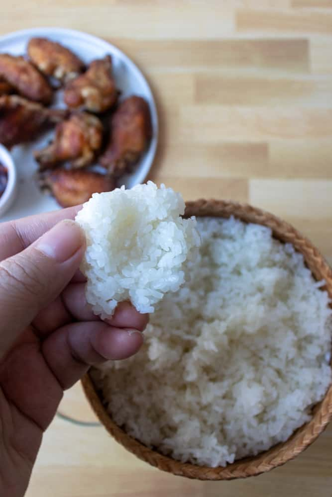 sticky rice (khao niew) being made into a rice ball