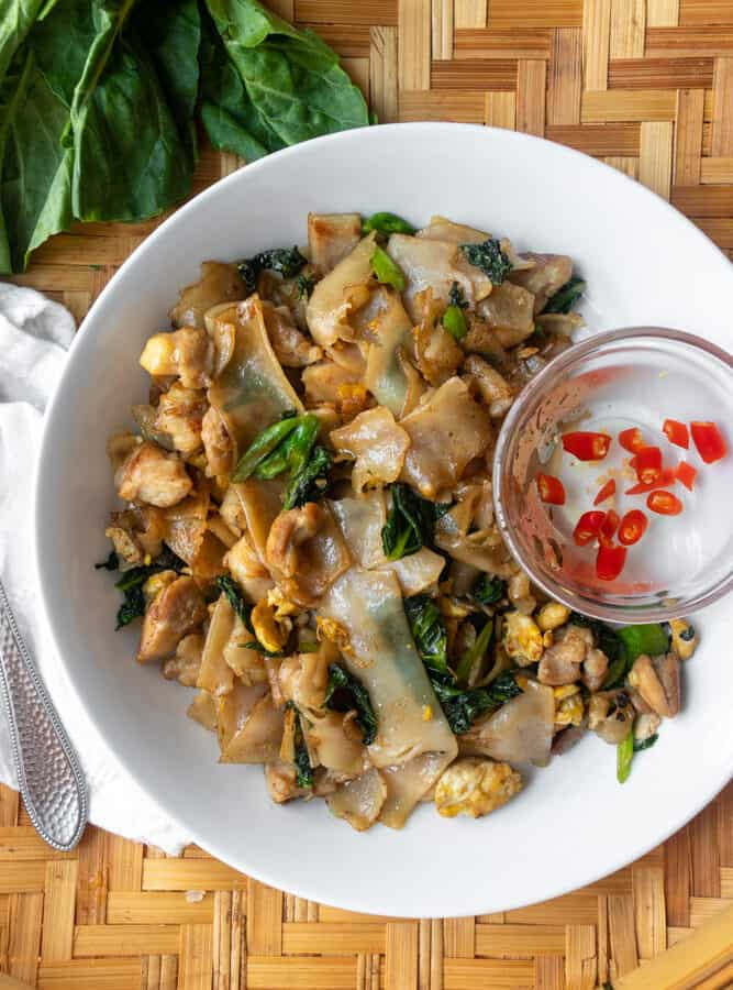 pad see ew on a plate with chili vinegar