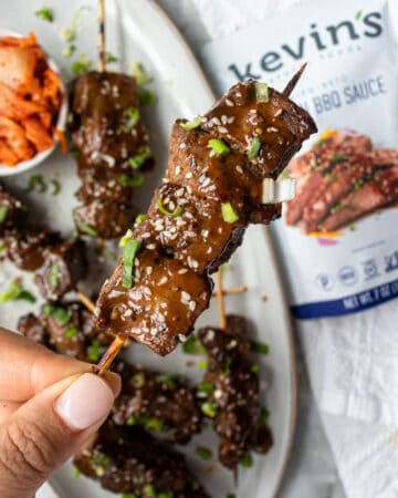 one of the Korean BBQ Skewers being held up to see a close up
